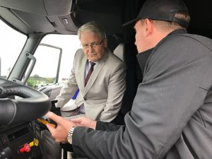 Federal Transport Minister Marc Garneau looks at an ELD
